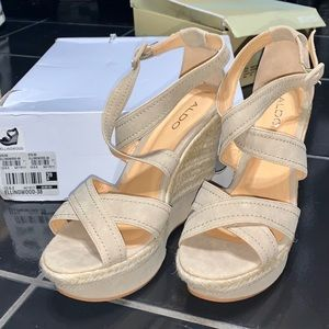 Aldo wedge sandle. Never worn w box.